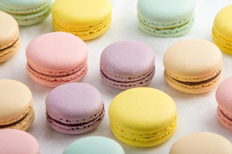 Colorful macarons on a white background. French dessert royalty free stock image