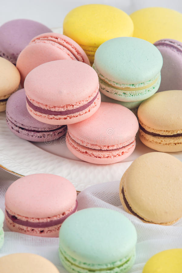 Colorful macarons on a white background. French dessert stock photo