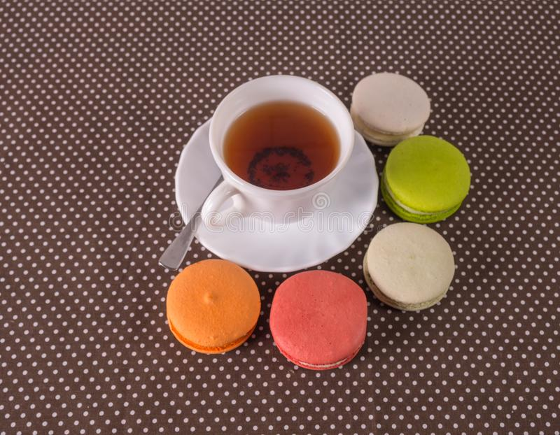 Colorful macaroon with white cup tea stock images
