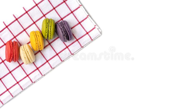 Macaroons on red and white cloth. Colorful macaroons on red and white cotton cloth. Isolated on whire background, top, view, food, macaron, macarons, sweet, cake royalty free stock photography