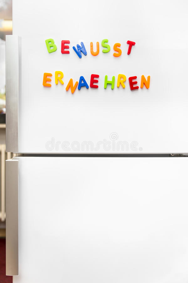 Colorful magnet letters with german text, healthy nutrition, cop stock image