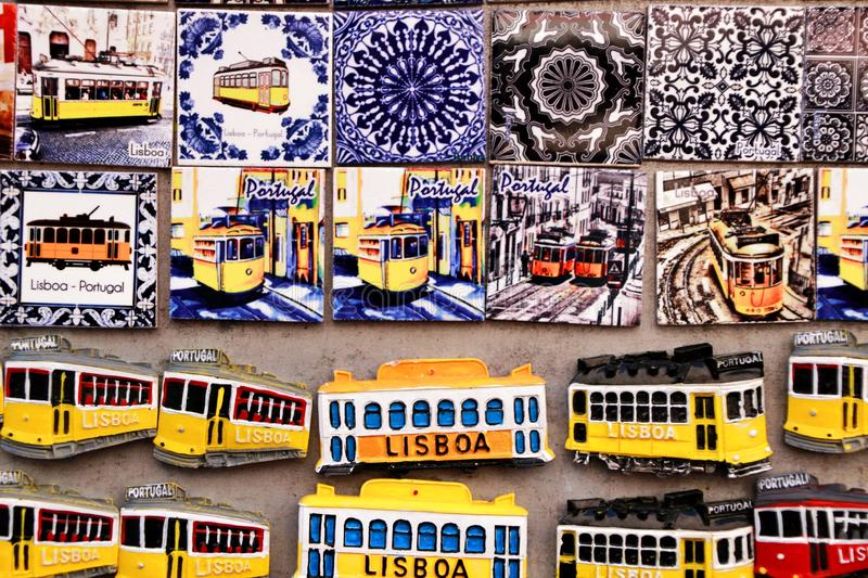 Colorful magnet souvenirs of Lisbon city. Colorful magnet tram and tiles souvenirs of Lisbon city. Word Lisbon written portugal historic tour tourism red royalty free stock image