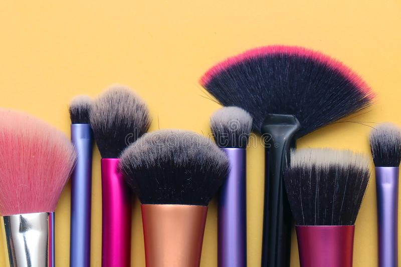 Colorful make up brushes. Colorful face and eyes make up brushes in a row royalty free stock photography