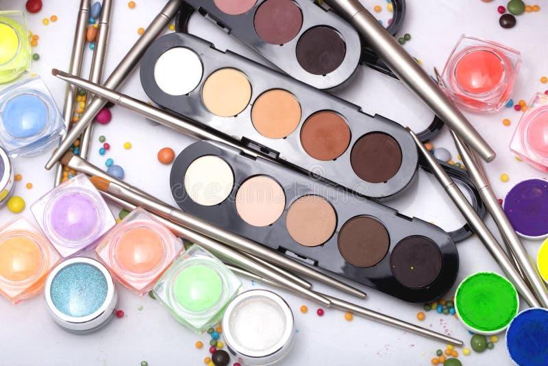 Colorful make-up set. Set of many professional visagiste eyeshadow palette red orange green violet pink yellow purple black beige brown colors foundation powder royalty free stock image