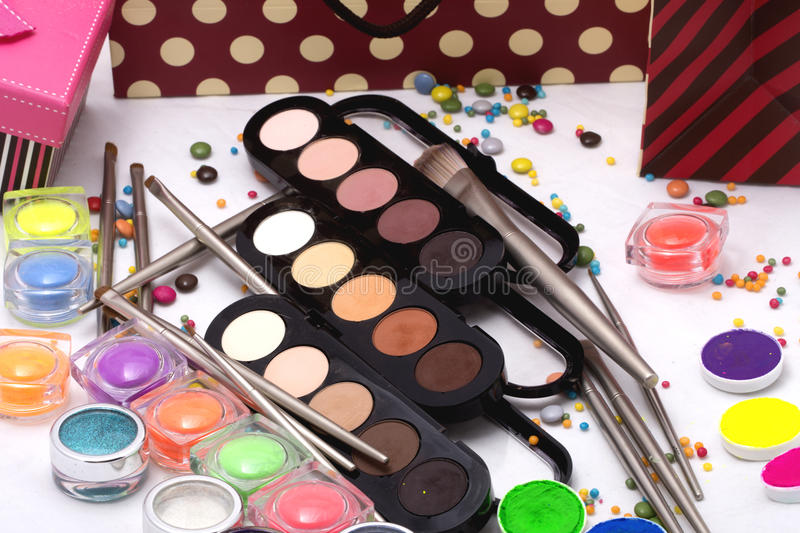 Colorful make-up set. Set of many professional visagiste eyeshadow palette red orange green violet pink yellow purple black beige brown colors foundation powder royalty free stock photography