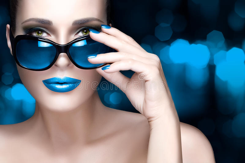 Colorful Makeup. Fashion Model Woman in Black Oversized Sunglasses stock photos