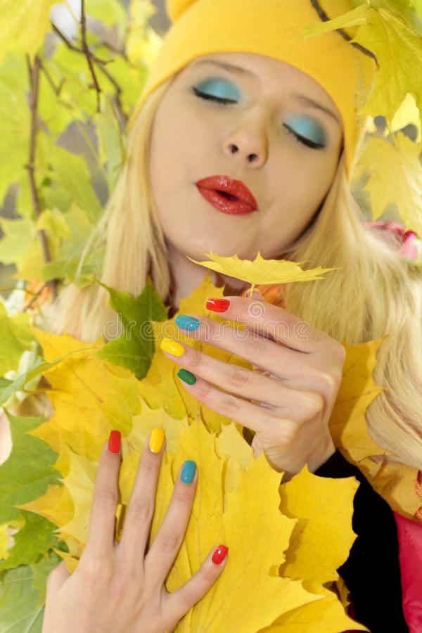Colorful makeup and manicure Golden autumn. stock images