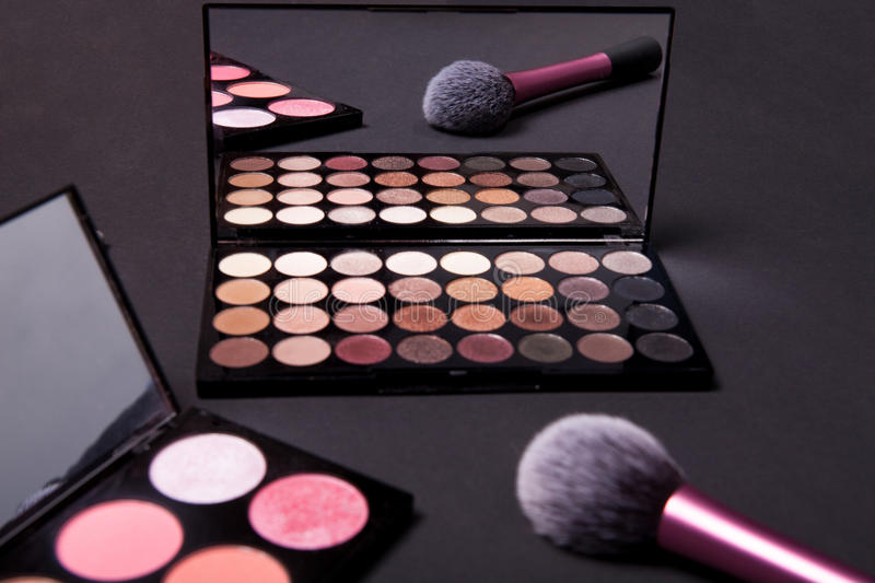 Download Colorful Makeup Palette And Brush To Apply Powder. On Pure Black Background. Stock Photo - Image: 83722339