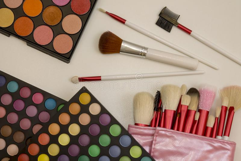 Colorful makeup set of eye shadows and brushes royalty free stock photo