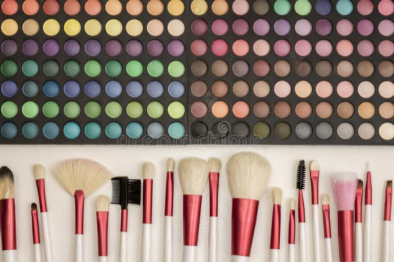 Colorful makeup set of eye shadows and brushes stock photos