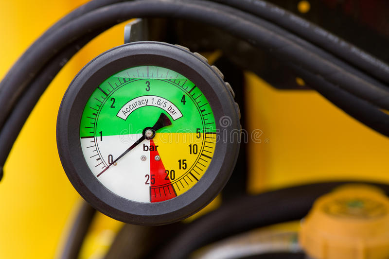 Colorful manometer. Close up of colorful manometer on agricultural machinery stock photo