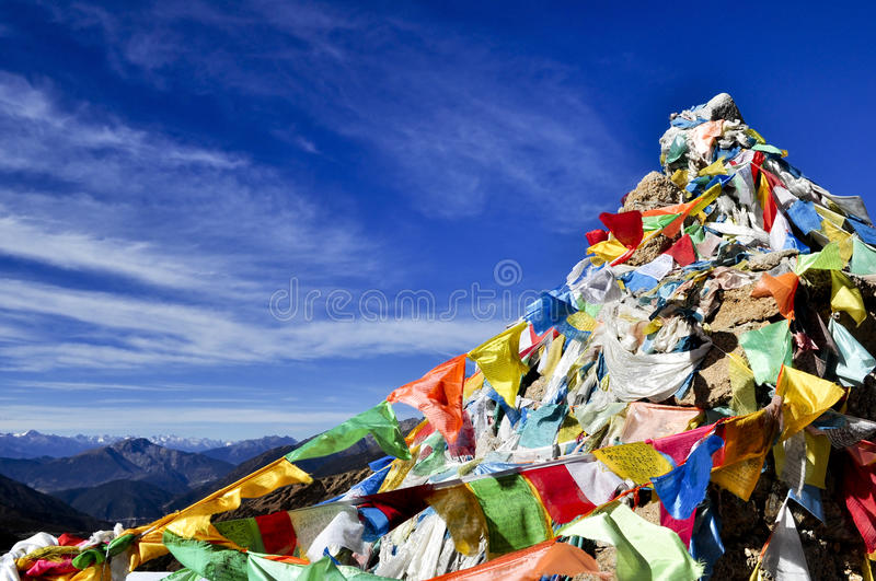 Download Colorful Mantra Flag In Blue Sky Stock Image - Image: 27119333