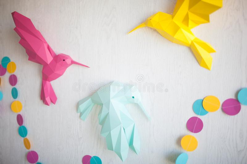 Origami birds made of colored paper. royalty free stock photos