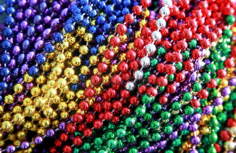 Colorful Mardi Gras Beads stock photos