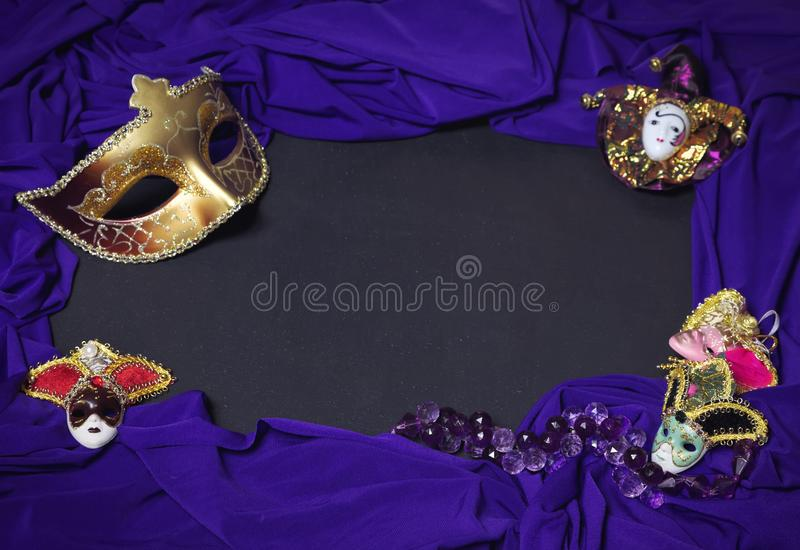 Colorful Mardi Gras or Carnival masks as frame on blackboard. stock photos