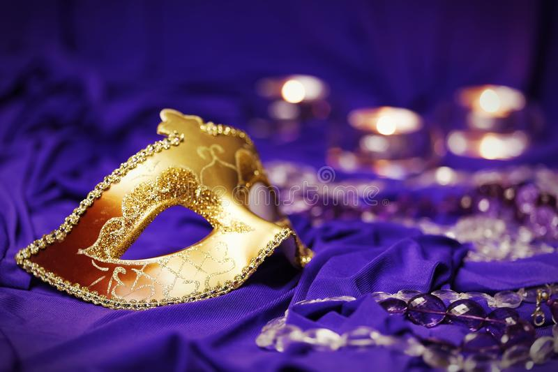 Colorful Mardi Gras or Carnival masks group on a purple background. stock image