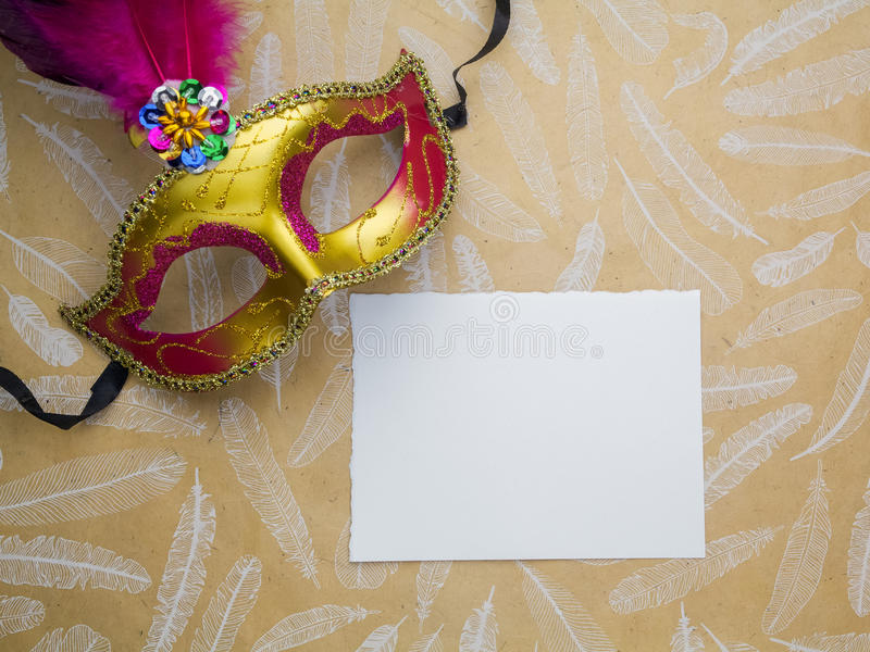 Colorful mardi gras or carnivale mask on a gold background. Venetian masks. top view. stock photo