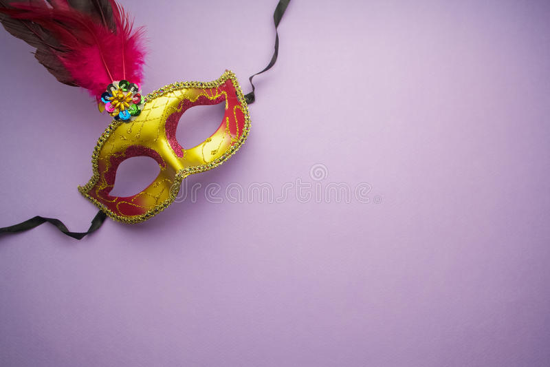 Colorful mardi gras or carnivale mask on a purple background. Venetian masks. top view. royalty free stock photo