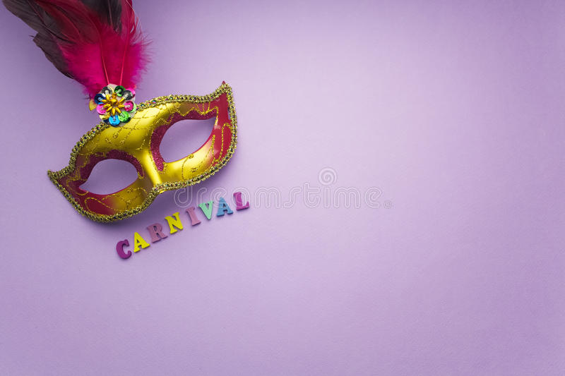 Colorful mardi gras or carnivale mask on a purple background. Venetian masks. top view. stock photo