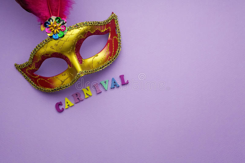 Colorful mardi gras or carnivale mask on a purple background. Venetian masks. top view. royalty free stock images