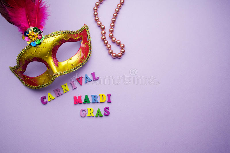 Colorful mardi gras or carnivale mask on a purple background. Venetian masks. top view. stock image