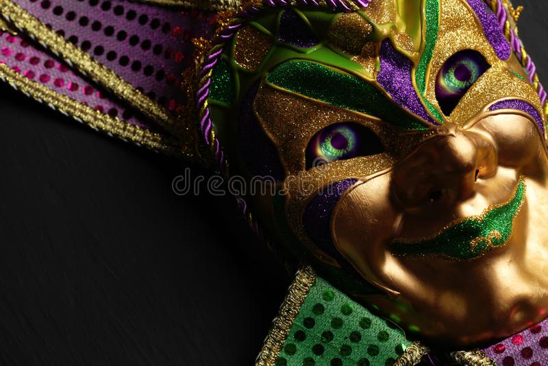 Colorful Mardi Gras mask with creepy eyes. Colorful Mardi Gras jester mask with creepy eyes stock photo