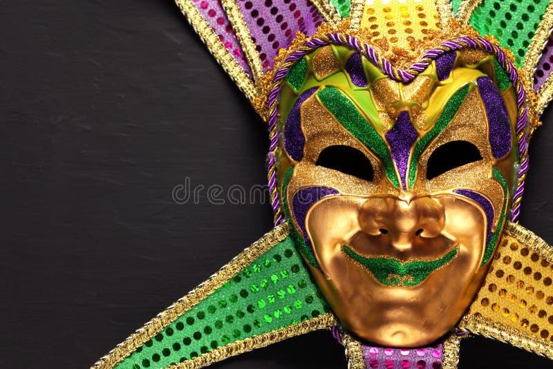 Colorful Mardi Gras mask background stock images