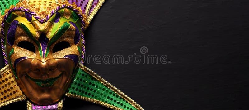 Colorful Mardi Gras mask background royalty free stock image