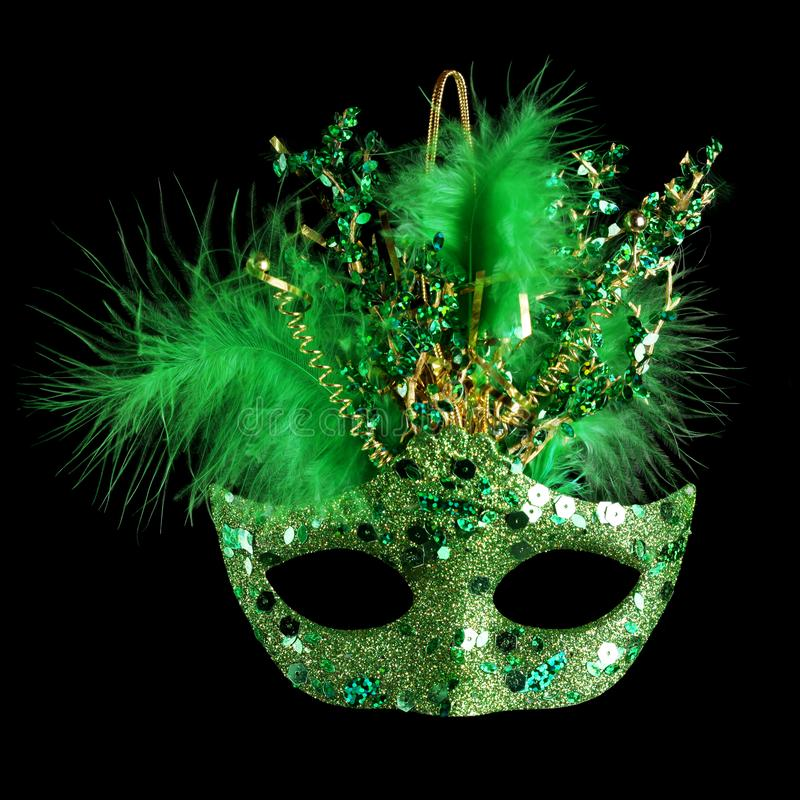 Colorful Mardi Gras mask isolated on black stock images