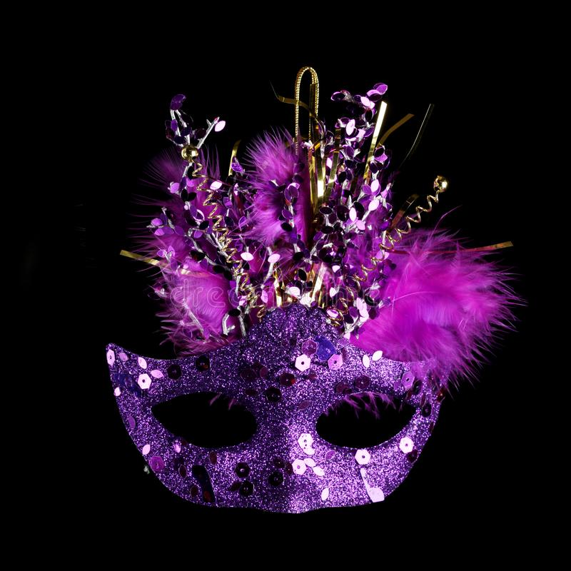 Colorful Mardi Gras mask isolated on black royalty free stock image