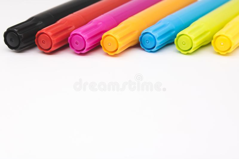 Colorful marker pen set on isolated background. Vivid highlighter and blank space for your design or montage stock photos