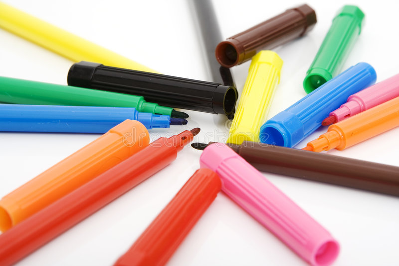Colorful markers and caps. Isolated against white background stock photos