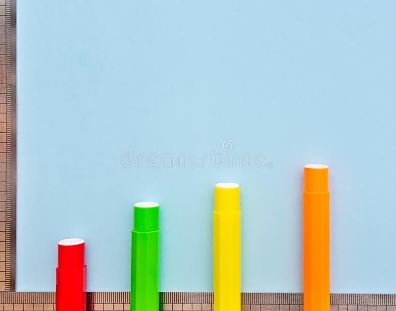 Colorful markers and rulers on light blue background stock photo