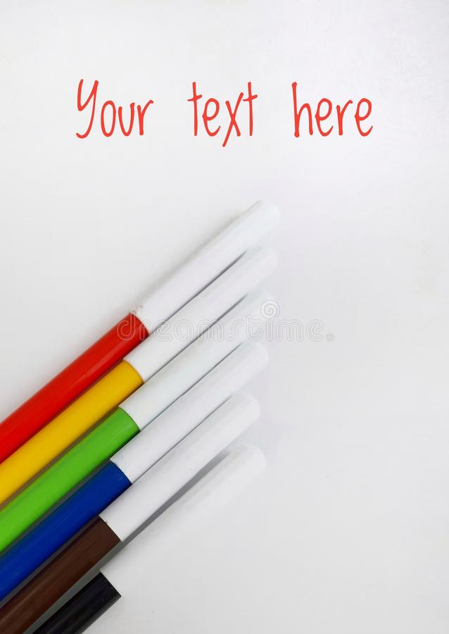 Colorful markers on white royalty free stock photo