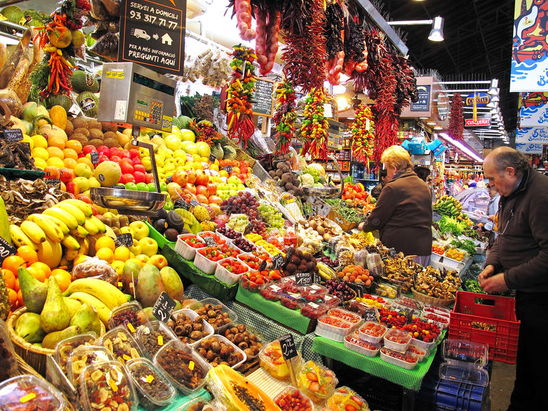 Colorful market stall. Colorful stall with fresh fruits and vegetables at a market in Barcelona stock images
