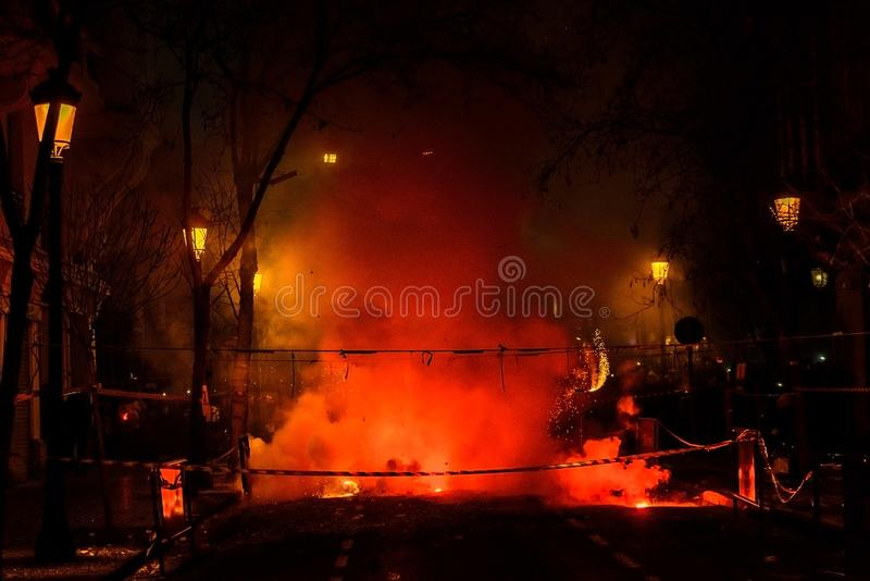 Colorful mascleta full of firecrackers and fireworks with lots of smoke and sparks royalty free stock images