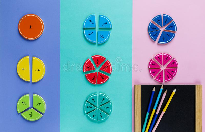 Colorful math fractions on the pink blue violet  bright backgrounds. Interesting math for kids. Education, back to school concept. royalty free stock image