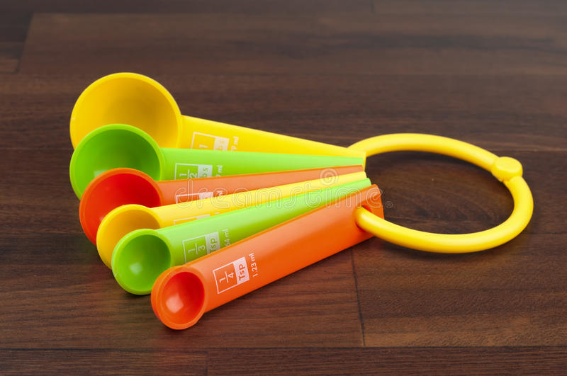 Colorful measuring spoons. stock photos