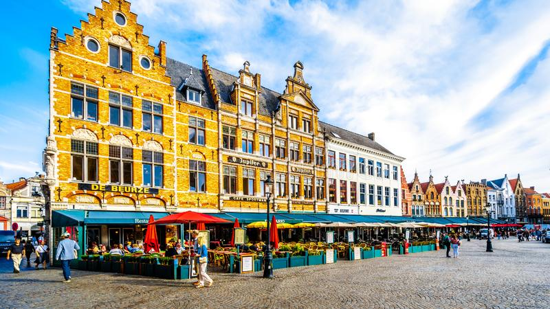 The colorful medieval houses with Step Gables lining the central Markt Market Square in the heart of Bruges, Belgium stock photo