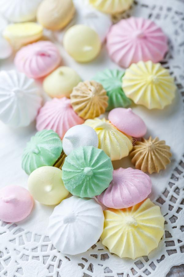 Colorful meringue cookies on napkin, natural light selective focus. Sweet pastry stock photo