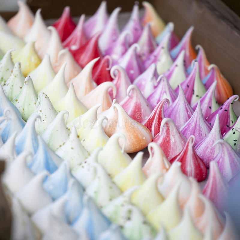 Colorful meringue for sale. At the Christmas fair stock images