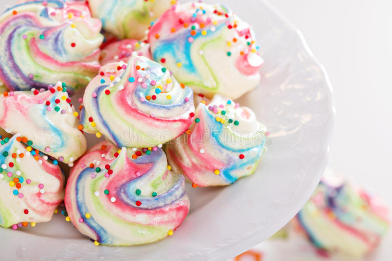 Colorful meringues rainbow colors royalty free stock image