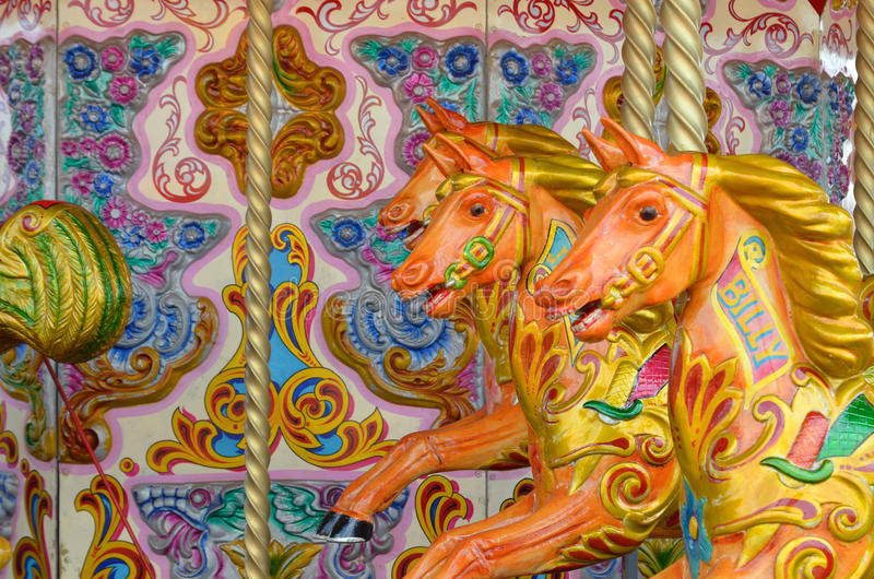 Colorful merry-go-round. With horses for childs stock image