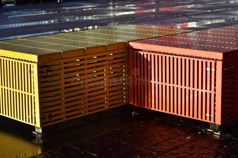Colorful metal benches after rain royalty free stock images