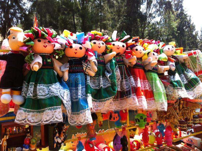 Colorful Mexican Dolls in traditional costume stock photos