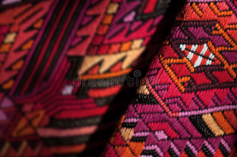 Colorful mexican fabric. Close-up shot of a colorful geometrical fabric stock image