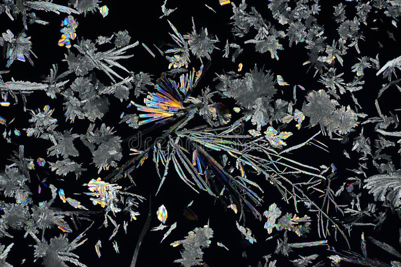 Colorful micro crystals in polarized light. Photo through a microscope royalty free stock photography
