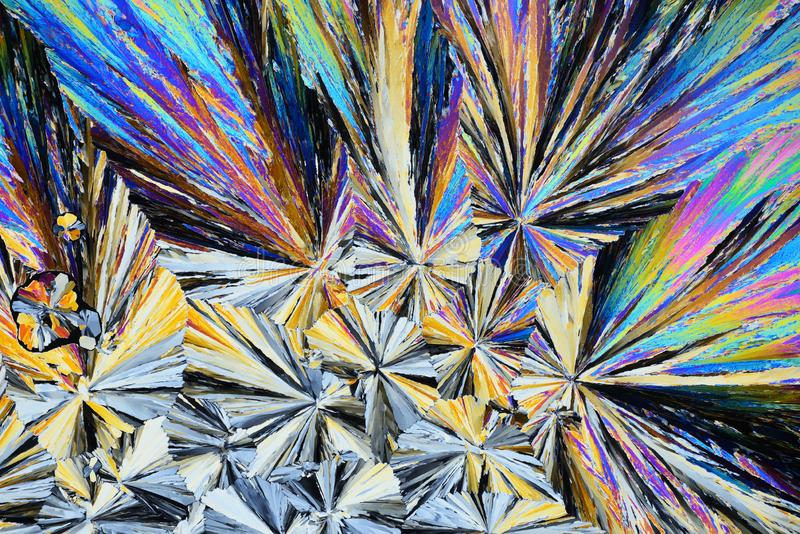 Colorful micro crystals in polarized light. Photo through a microscope royalty free stock images