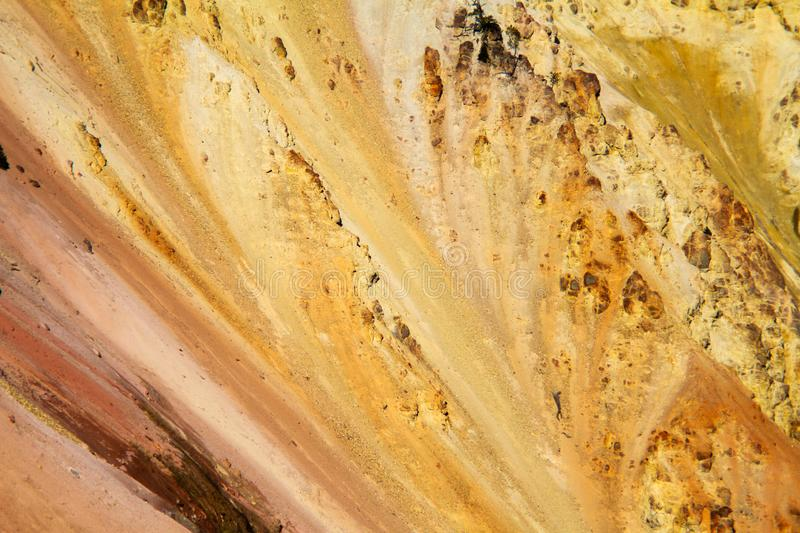 Colorful Mineral Dirt. Colorful mineral rich dirt on the side of a mountain in Yellowstone National Park, Wyoming royalty free stock photo