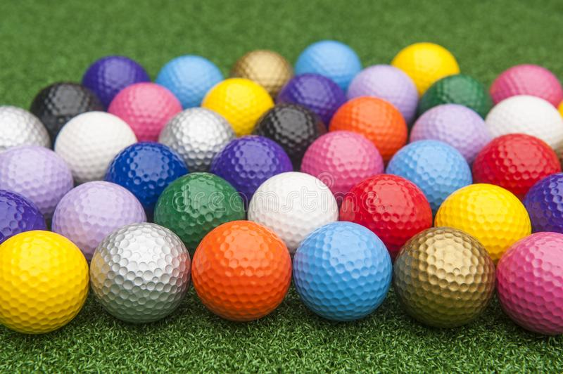 Colorful Miniature Golf Balls on Grass royalty free stock photo